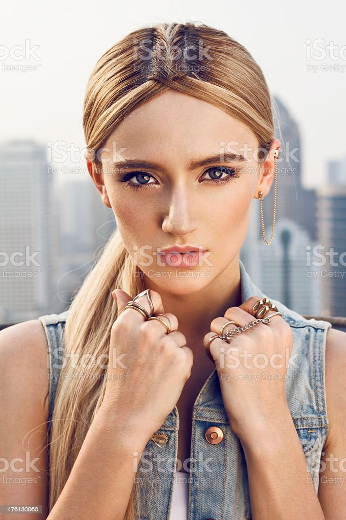 Beautiful young woman on the rooftop stock photo