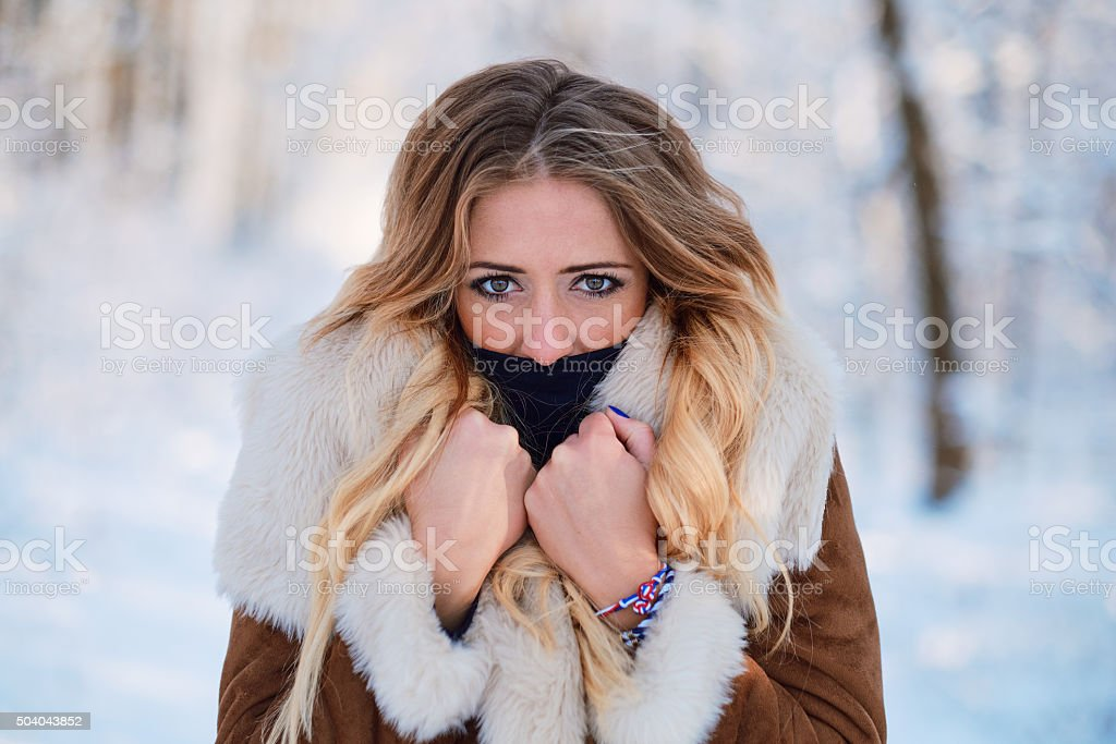 Beautiful young woman outdoor winter portrait stock photo