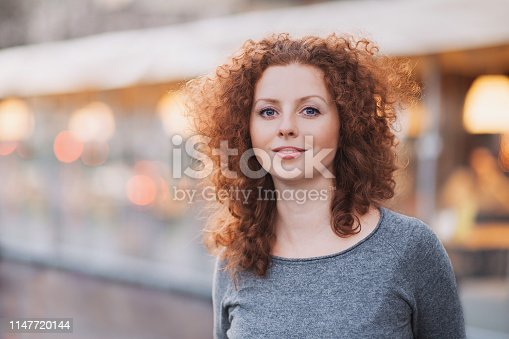 Smiling girl portrait in a city