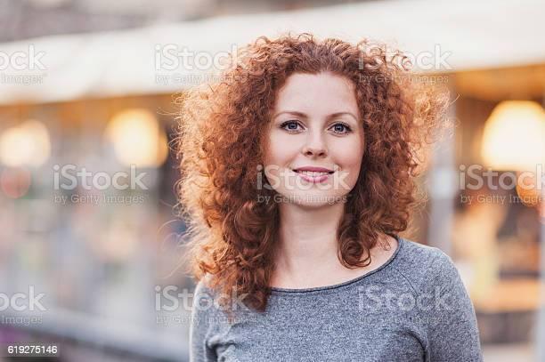 Gorgeous redhead woman outdoors portrait