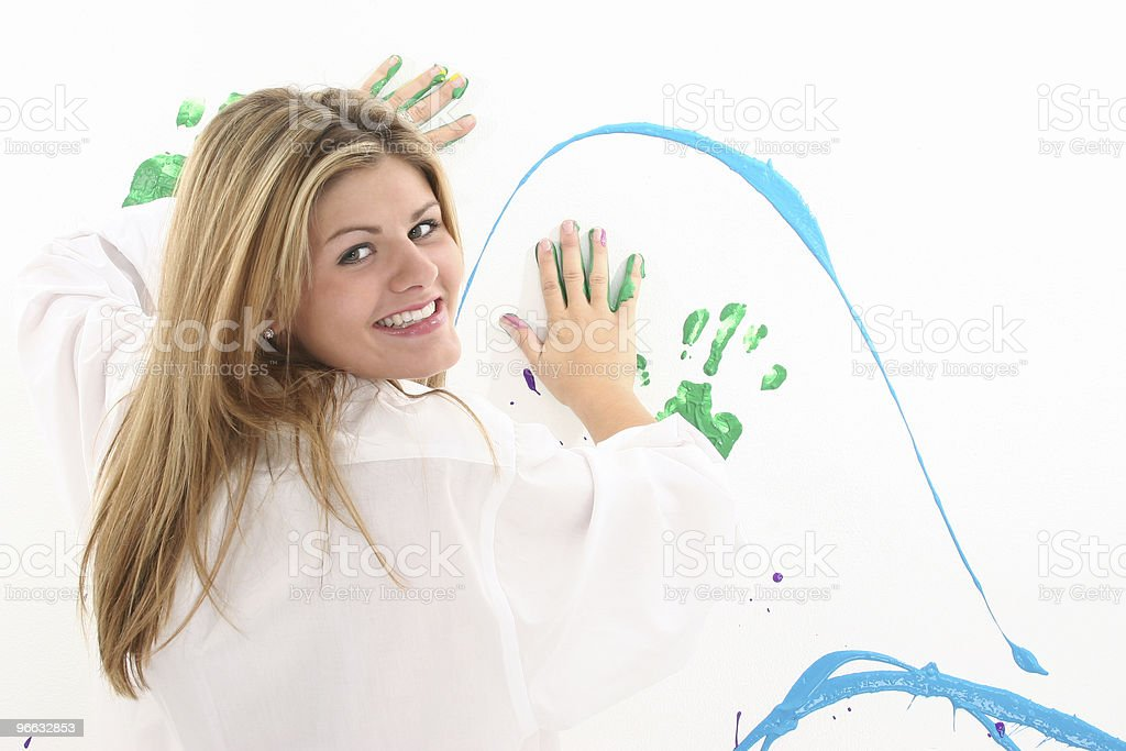 Beautiful Young Woman Painting on Wall royalty-free stock photo
