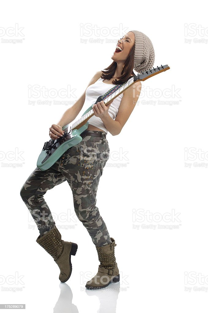 Beautiful young woman playing a guitar royalty-free stock photo