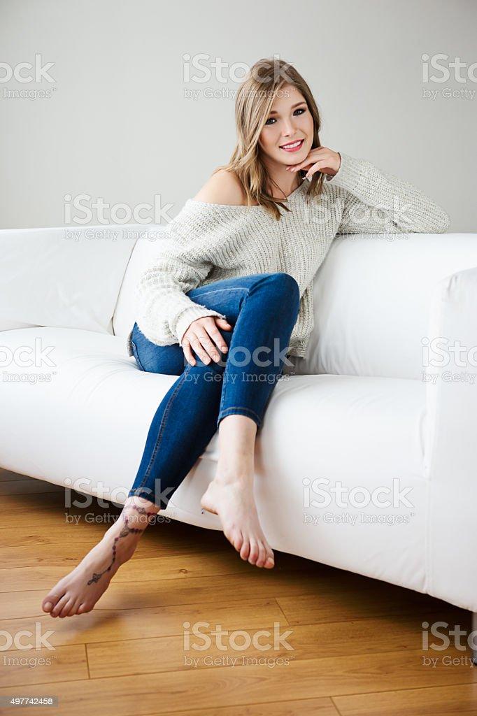 Beautiful Young Woman Posing On Sofa Stock Photo
