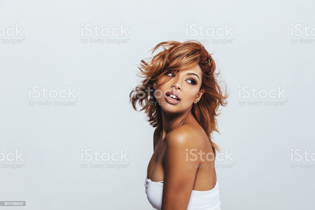 Beautiful young woman posing on white background stock photo