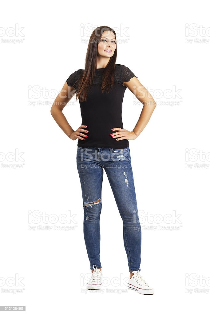 Beautiful young woman posing with arms on her hips stock photo