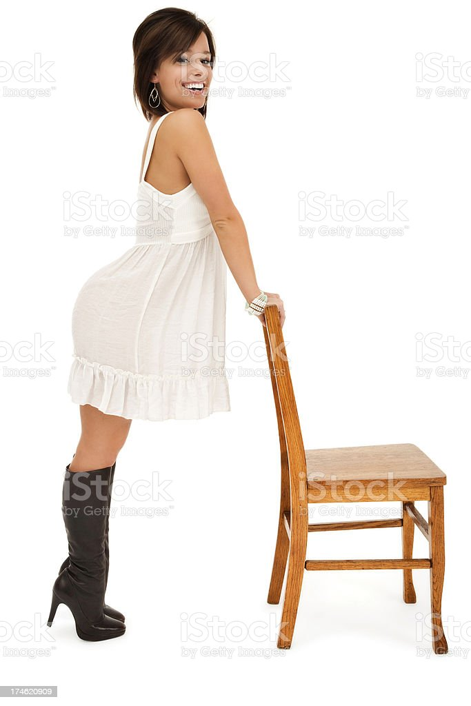 Beautiful Young Woman Posing with Wooden Chair royalty-free stock photo