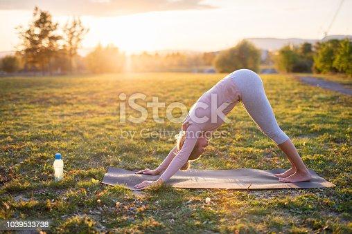Practising yoga in nature.