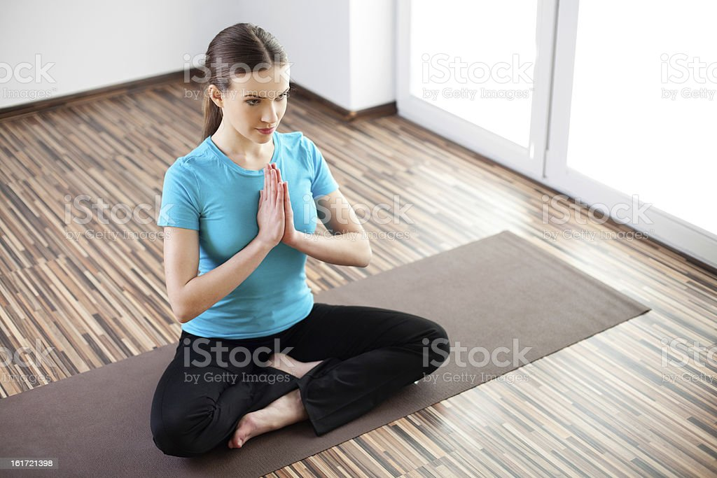 Beautiful young woman practicing at home royalty-free stock photo