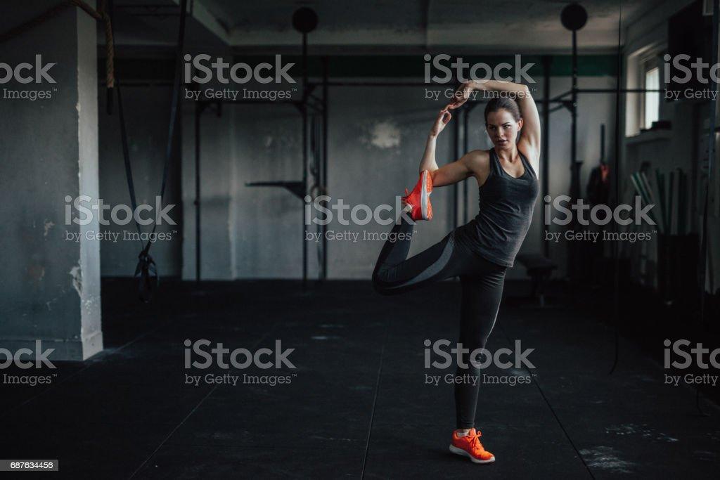Beautiful young woman practicing yoga stock photo