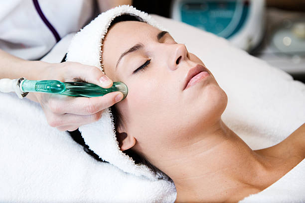 Beautiful young woman receiving cupping treatment in spa. Portrait of beautiful young woman receiving cupping treatment in spa. suction tube stock pictures, royalty-free photos & images
