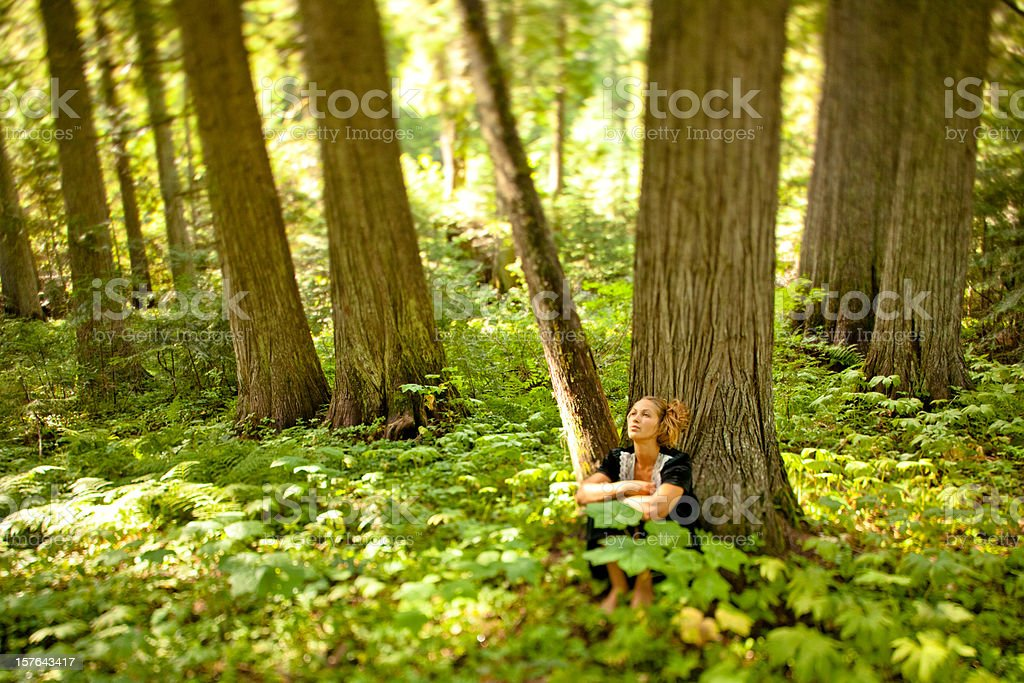 Beautiful young woman relaxing and appreciating nature royalty-free stock photo