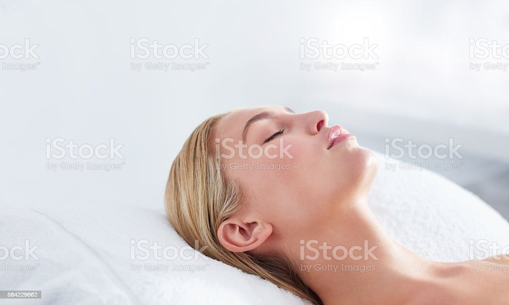 Beautiful young woman relaxing at spa stock photo