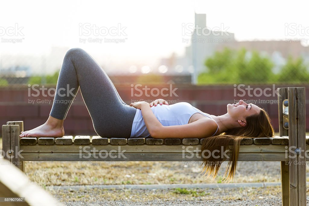 Beautiful young woman relaxing in the park. stock photo