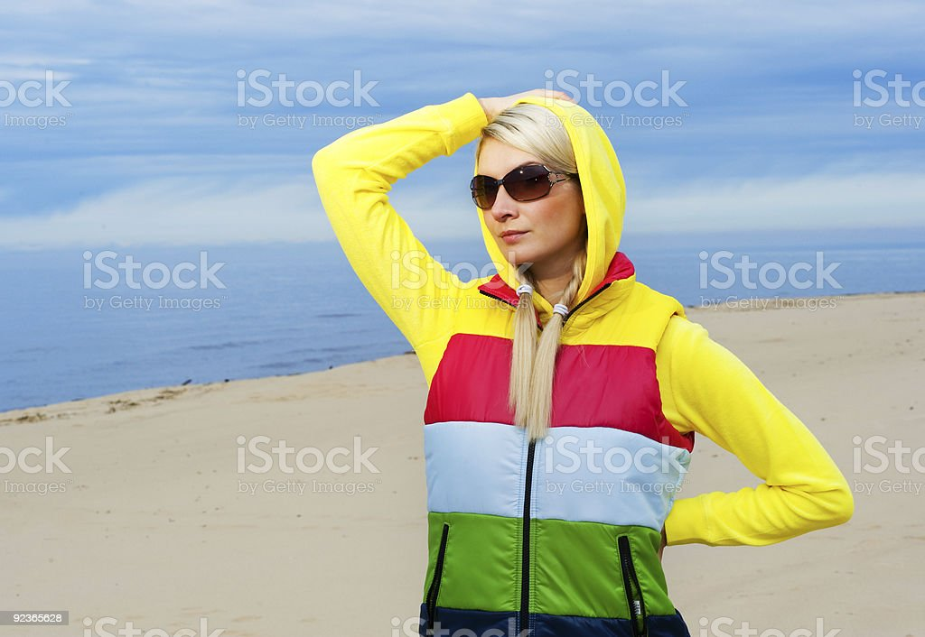 Beautiful young woman relaxing near the sea royalty-free stock photo
