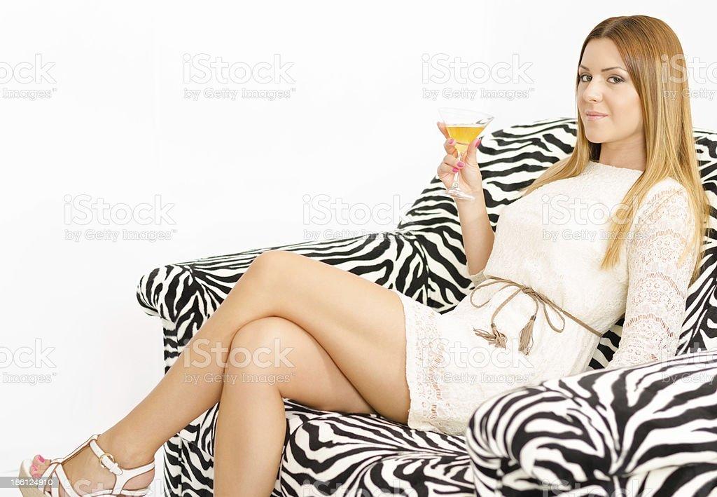 Beautiful young woman relaxing on sofa stock photo