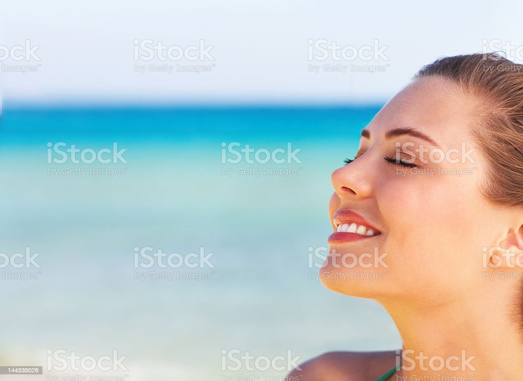 Beautiful young woman relaxing on the beach royalty-free stock photo