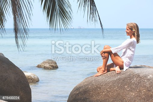 670374358 istock photo Beautiful young woman relaxing on the beach 675400224