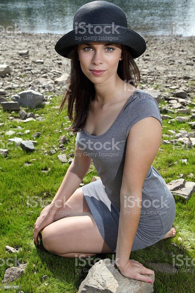 Beautiful young woman relaxing on the grass royalty-free stock photo