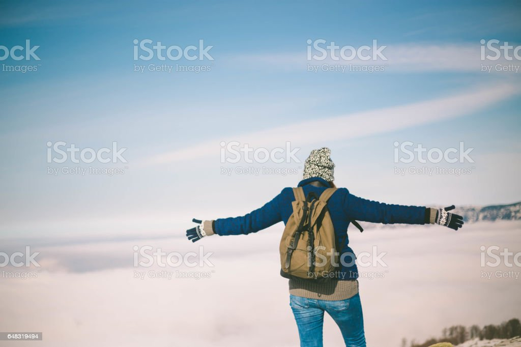 beautiful young woman relaxing outdoor in a winter day stock photo
