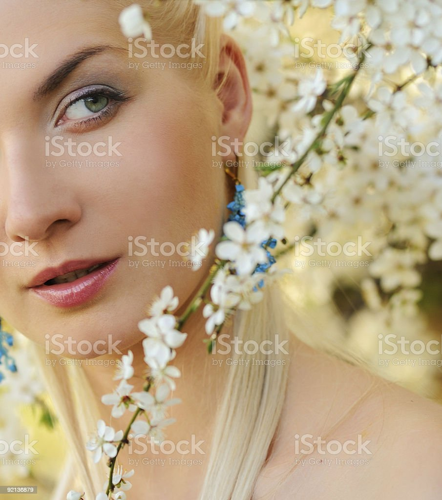 Beautiful young woman relaxing outdoors royalty-free stock photo