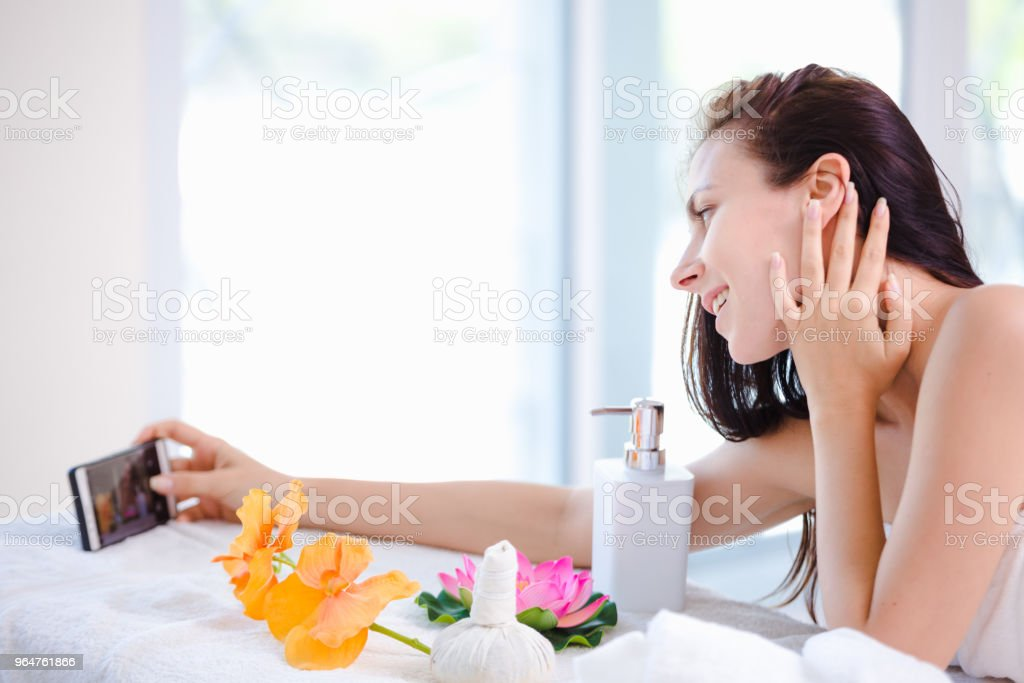 Beautiful young woman relaxing spa royalty-free stock photo