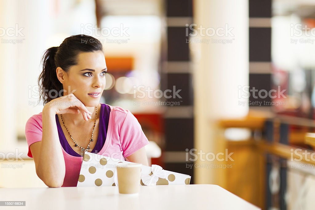beautiful young woman resting in cafe royalty-free stock photo