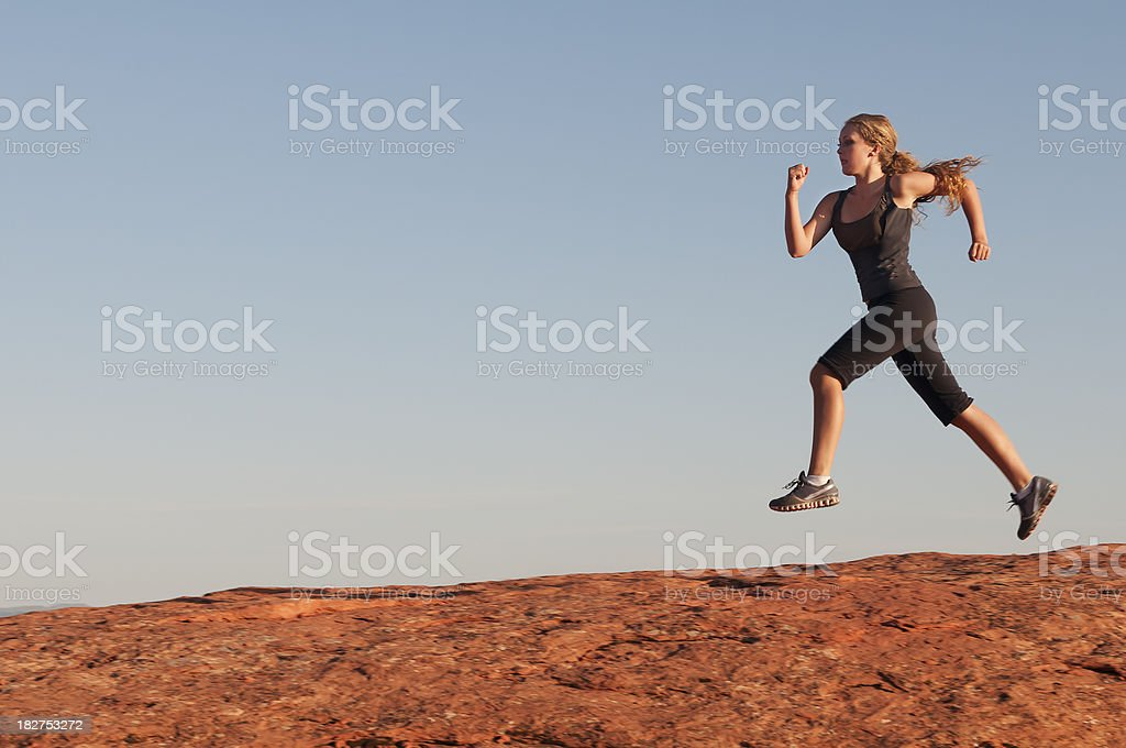 Beautiful young woman running - IV royalty-free stock photo