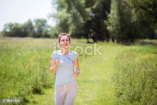 479652946istockphoto Beautiful young woman runs 479641404