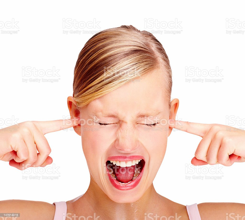 Beautiful young woman screaming against white background stock photo