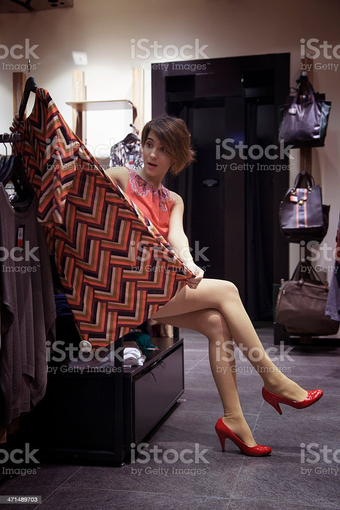 Beautiful young woman shopping in a clothing store royalty-free stock photo