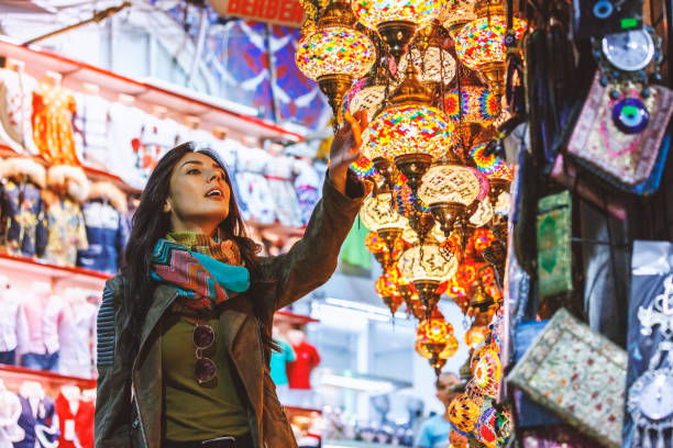 Beautiful young woman shopping in Grand Bazaar, Istanbul, Turkey stock photo