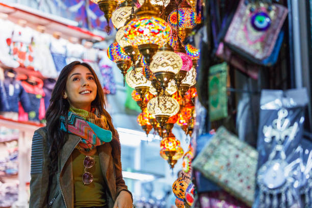 Beautiful young woman shopping in Grand Bazaar, Istanbul, Turkey Beautiful young woman shopping in Grand Bazaar, Istanbul, Turkey asian market stock pictures, royalty-free photos & images