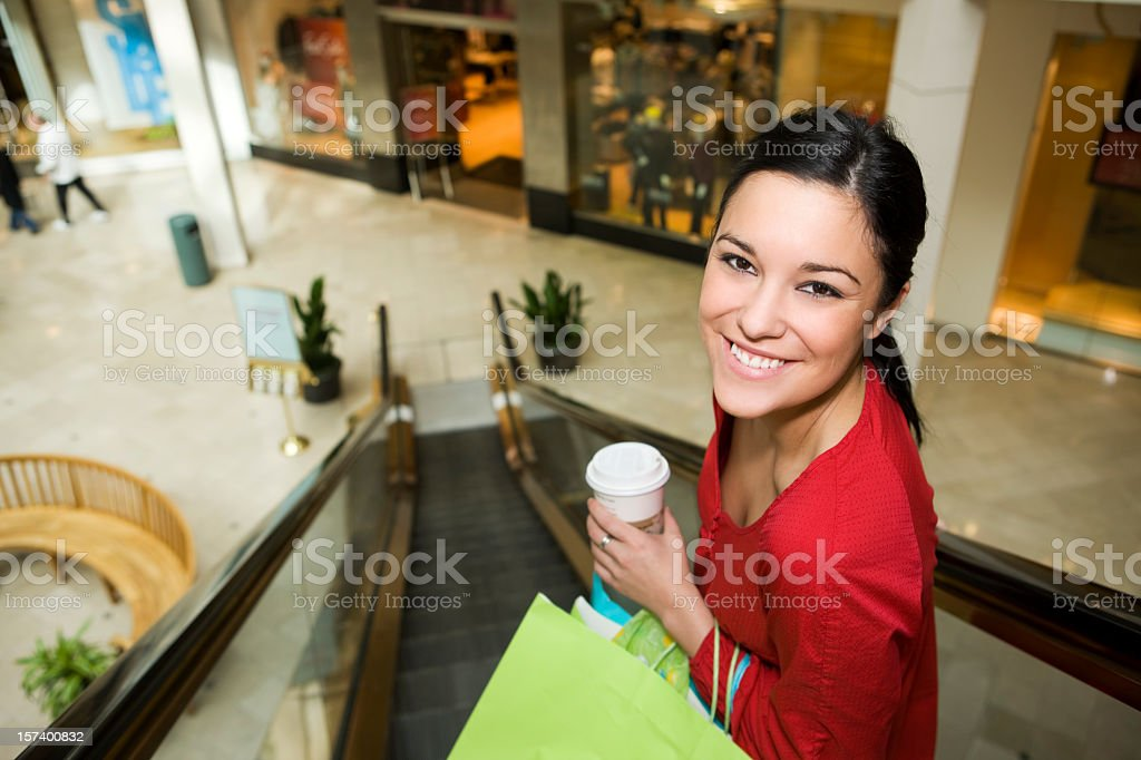 Beautiful Young Woman Shopping in Mall at Christmas, Copy Space royalty-free stock photo