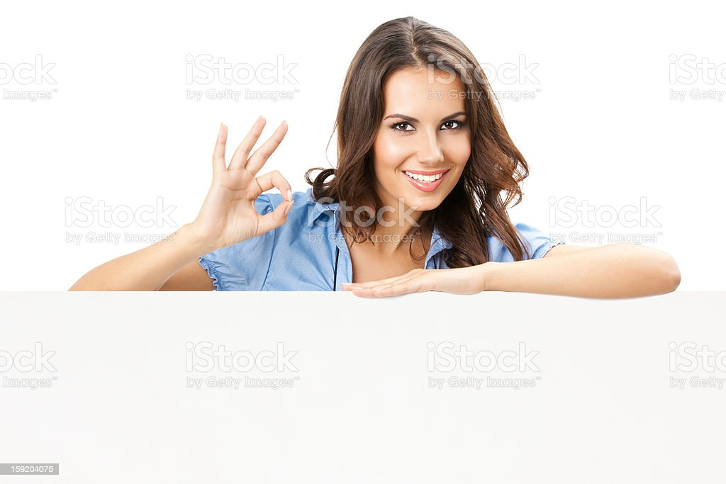 Beautiful young woman showing blank signboard royalty-free stock photo
