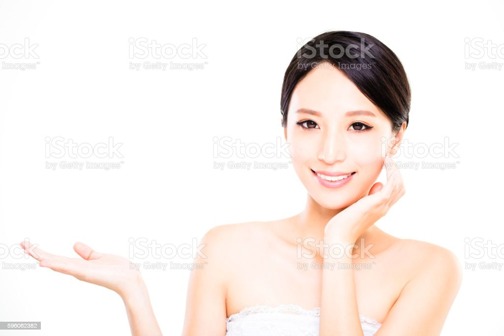 Beautiful young woman showing empty  on the open hand royalty-free stock photo