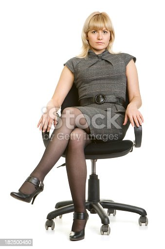 Beautiful Young Woman Sitting In An Office Chair Stock