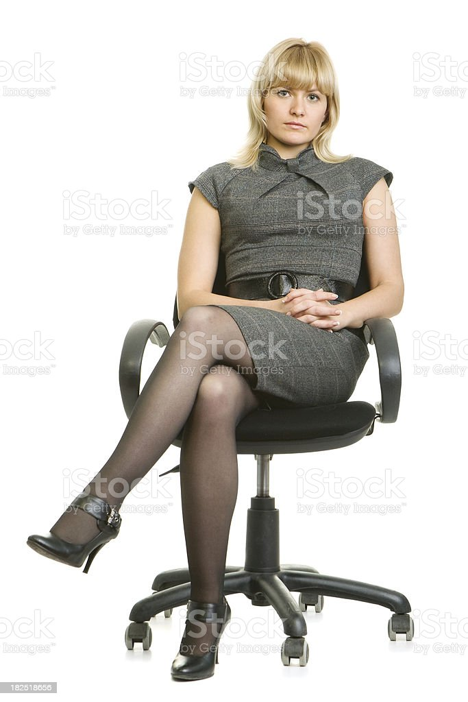 royalty free office chair women sitting legs crossed at