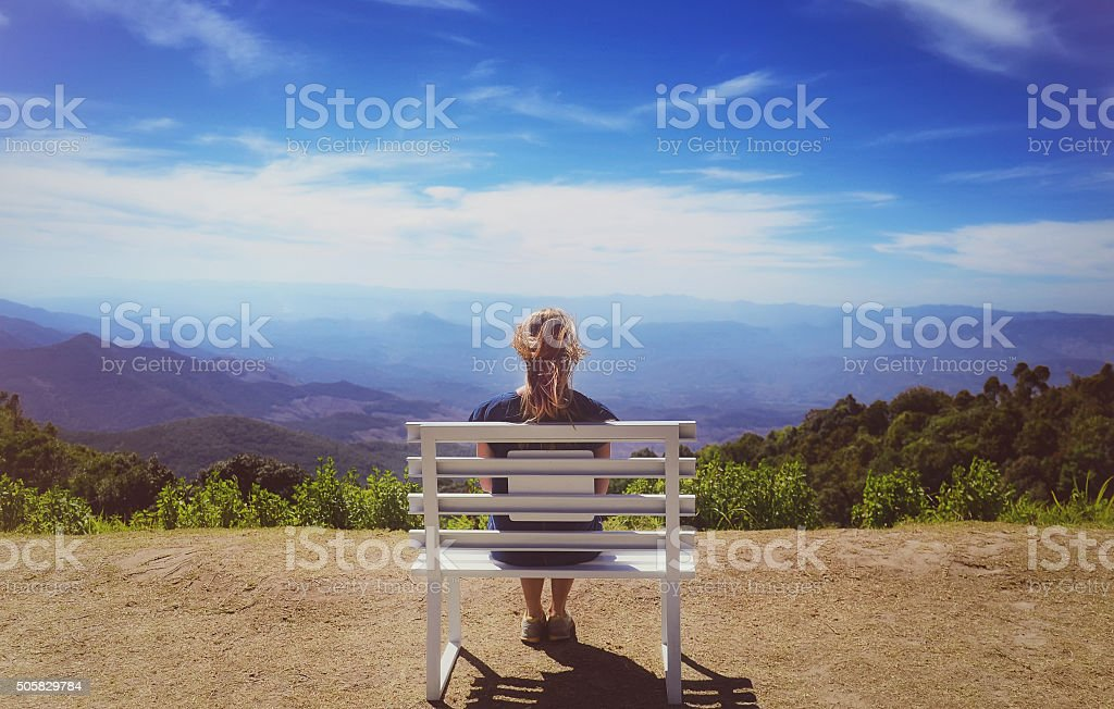 Beautiful young woman  sitting on a bench at Doi Inthanon stock photo