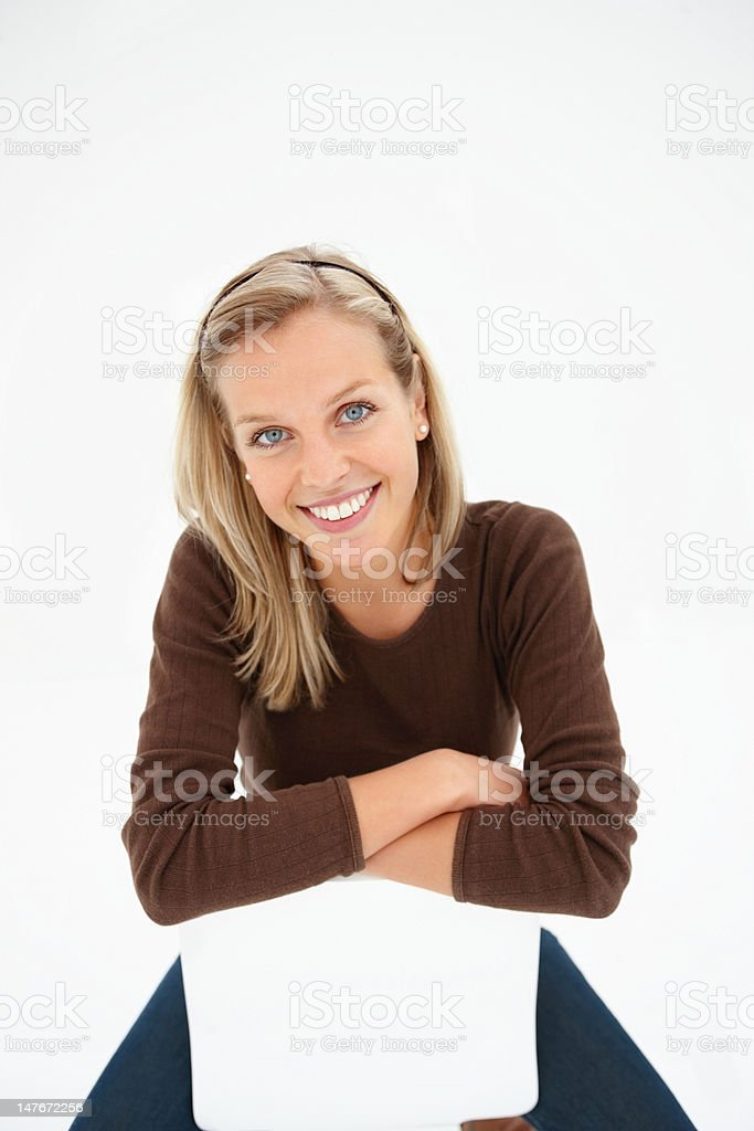Beautiful young woman sitting on chair royalty-free stock photo