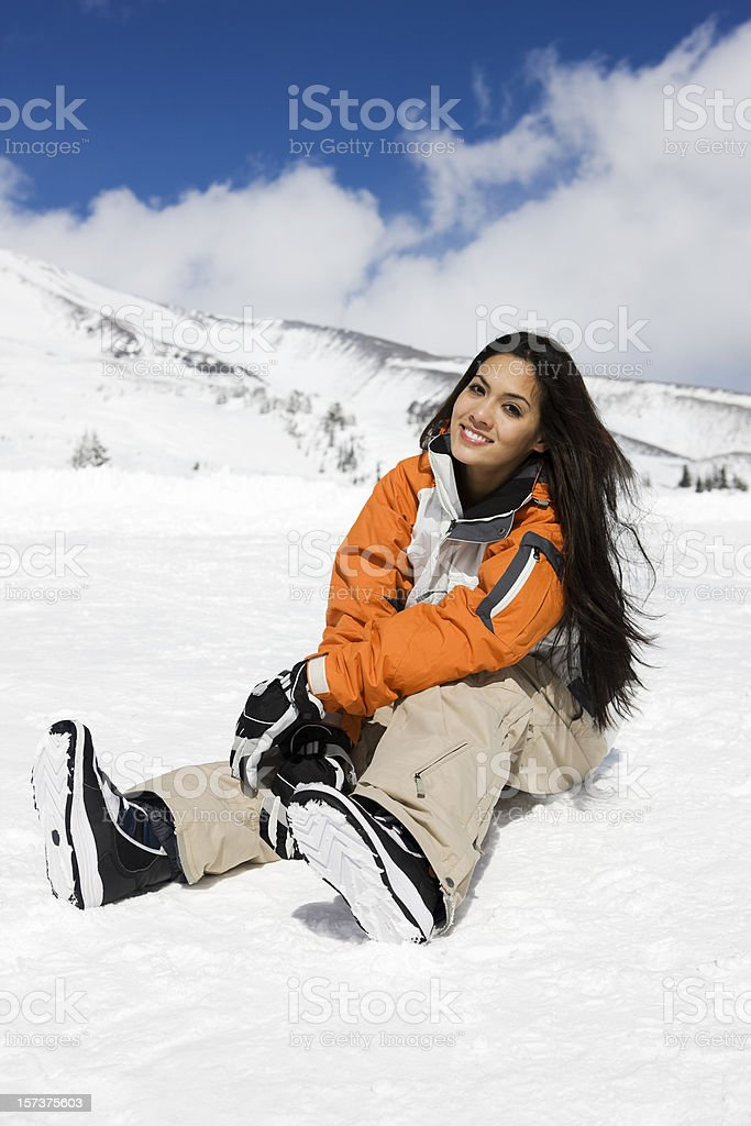 Beautiful Young Woman Sitting on Mountain Snow, Sunny Day, Copyspace royalty-free stock photo