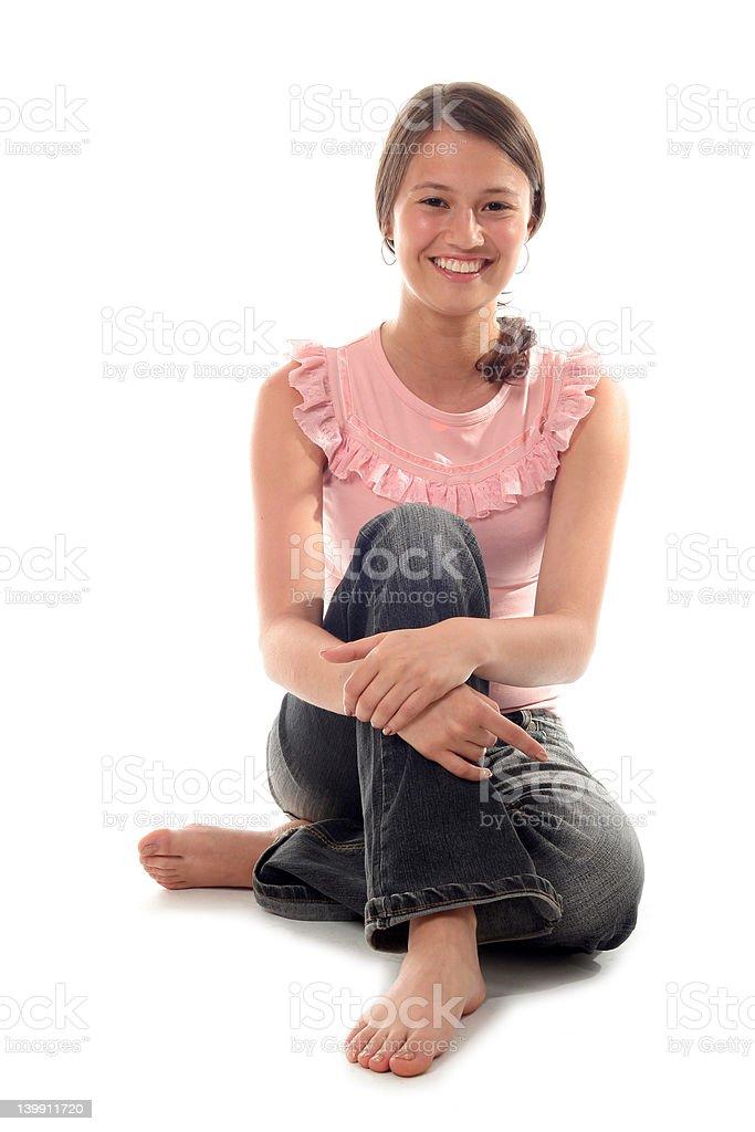 Beautiful young woman sitting royalty-free stock photo