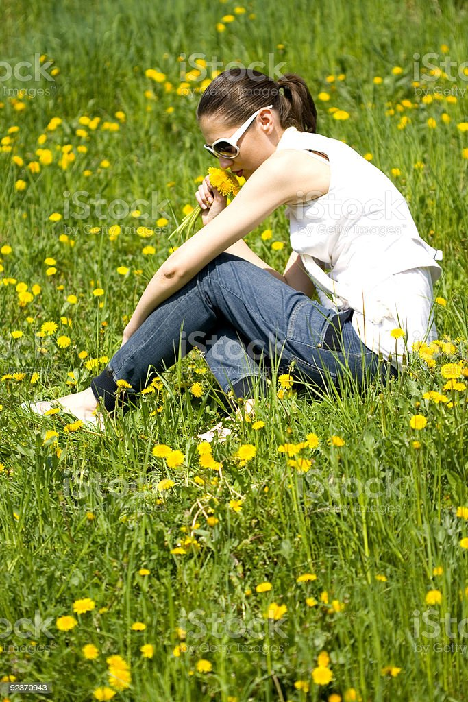 beautiful young woman smelling flowers royalty-free stock photo