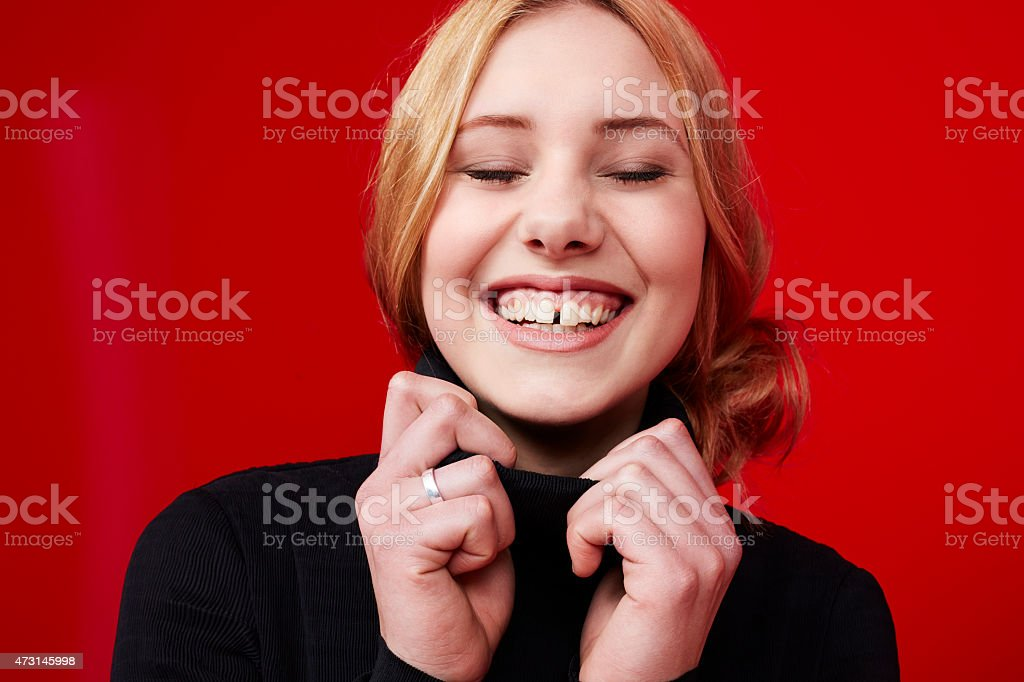 Beautiful young woman smiling stock photo