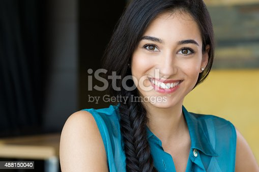 istock Beautiful young woman smiling 488150040