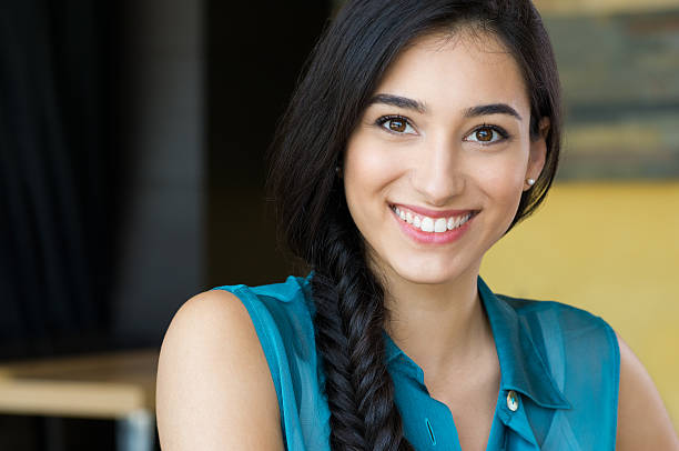 Beautiful young woman smiling Closeup shot of young woman smiling. Portrait of brunette girl looking at camera and smiling. Shallow depth of field with focus on beautiful young happy girl with braid smiling. 18 19 years stock pictures, royalty-free photos & images