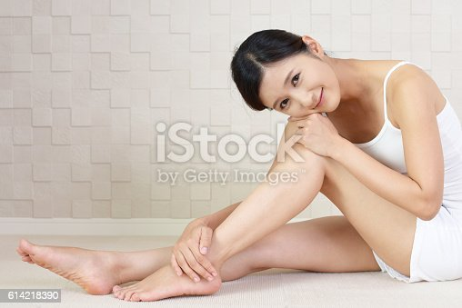 istock Beautiful young woman smiling 614218390