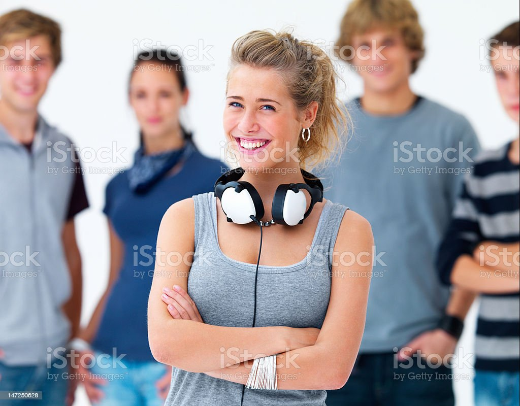Beautiful young woman smiling with her friends in the background royalty-free stock photo