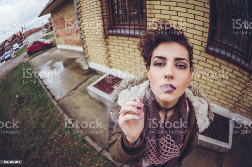 Beautiful Young Woman Smoking Cigarette Downtown Stock Photo