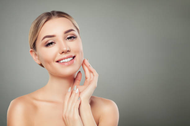 Beautiful Young Woman Spa Model with Healthy Skin, Cute Smile and Manicured Hands on Background with Copy space Beautiful Young Woman Spa Model with Healthy Skin, Cute Smile and Manicured Hands on Background with Copy space nude women pics stock pictures, royalty-free photos & images
