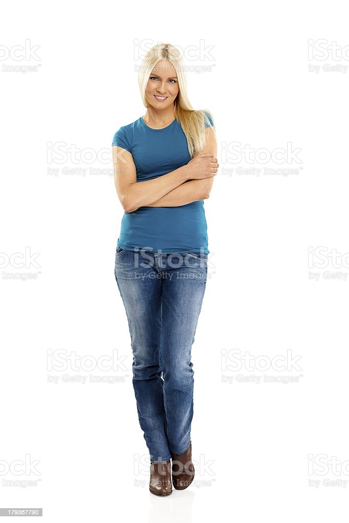 Beautiful young woman standing on white stock photo